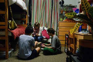 <p>From left, Tanner Burgdorf, a real estate and urban economics major, Danielle Lanslots, an environmental science major, and Trevor Biggs, also an environmental science major, in an EcoHouse dorm room. Photo by Jessica Tommaselli</p>