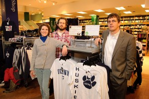<p>From left, Shareen Hertel, lChris Jeffords, and Lyle Scruggs with a display of fair trade and union-made clothing at the UConn Co-op. Photo by Peter Morenus</p>