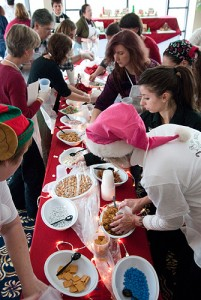 <p>Contestants race to get the ingredients they need at the start of the Gingerbread Competition. Photo by Frank Dahlmeyer</p>