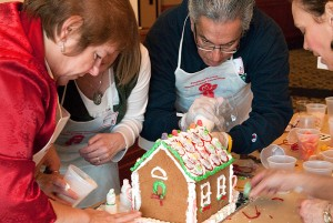 <p>Members of the Continuing Studies team work on their entry in the Gingerbread Competition. Photo by Frank Dahlmeyer</p>