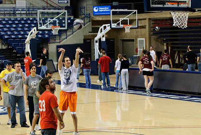 <p>Students play basketball for Hoops of Hope, a charity fundraiser for HIV/AIDS sufferers in Africa, part of World AIDS Week. The event took place in Gampel Pavilion on Dec. 1. Photo by Jessica Tommaselli</p>