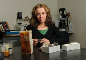 <p>Tiziana Matarazzo with samples at her lab in Beach Hall. Photo by Peter Morenus</p>