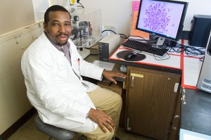 <p>John Ngunjiri, a Ph.D. student in molecular and cell biology, in his lab. Photo by Daniel Buttrey</p>