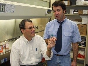 <p>Dr. Frank Nichols (seated) and Dr. Robert Clark at the UConn Health Center. Photo by Carolyn Pennington</p>