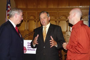<p>Richard Schwab, center, then dean of the Neag School of Education, speaks with Dennis Van Roekel, left, president of the National Education Association, and Barry Fargo, a New London teacher, after a 2008 press conference announcing the CommPACT initiative. Archival photo supplied by the Connecticut Education Association</p>