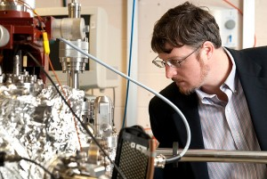 <p>Brian Willis, associate professor of chemical, materials, and biomolecular engineering, works with reactors in his lab. Photo by Frank Dahlmeyer</p>