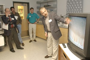 <p>J. Evan Ward, professor of marine sciences, shows visitors live video of research on mussels at his lab during a tour of the Marine Sciences Building. Photo by Peter Morenus</p>