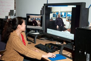 <p>Merlita Murphy, administrative services specialist, works in the new Thomas A. Wood Streaming Video Llab in Homer Babbidge Library. Photo by Frank Dahlmeyer</p>