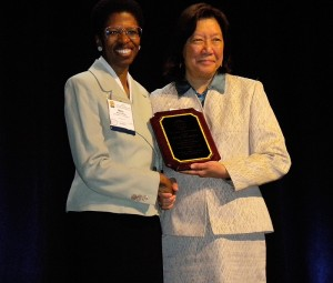 <p>Mary Romney, left, assistant professor in the International Teaching Assistants Program at the Institute for Teaching and Learning, receives the James Alatis Award for Teachers of English to Speakers of Other Languages Inc. (TESOL). The award was presented by Shelley Wong, past president, on March 25 at the organization's annual convention in Boston. Photo by Catherine Ross</p>