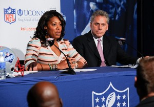 <p>Kelci Stringer, left, KSI founder and widow of Korey Stringer, and James Gould, Stringer's former NFL agent at a press conference announcing the formation of the Korey Stringer Institute. Photo by Peter Morenus</p>
