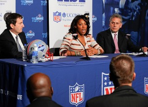 <p>From left, Gary Gerzog, senior VP of business affairs for the NFL, Kelci Stringer, KSI founder and widow of Korey Stringer, and James Gould, Stringer's former NFL agent at a press conference announcing the formation of the Korey Stringer Institute. Photo by Peter Morenus</p>