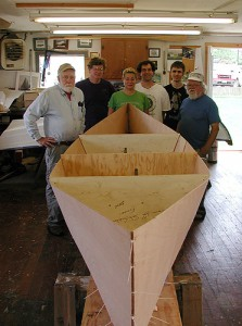 <p>Three undergraduates at the Avery Point campus learned to build Adirondack pack boats during an internship with Bill Armitage of the John Gardner Chapter of the Traditional Small Craft Association.  Shown here are (L to R) Stephen Jones, English professor at Avery Point and boating enthusiast; Bill Armitage of the TSCA, undergraduates Elizabeth Provenzano, Peter Omdahl, and Jon Turban; and Sandy E'Esposo of the TSCA. Photo by Christine Buckley</p>
