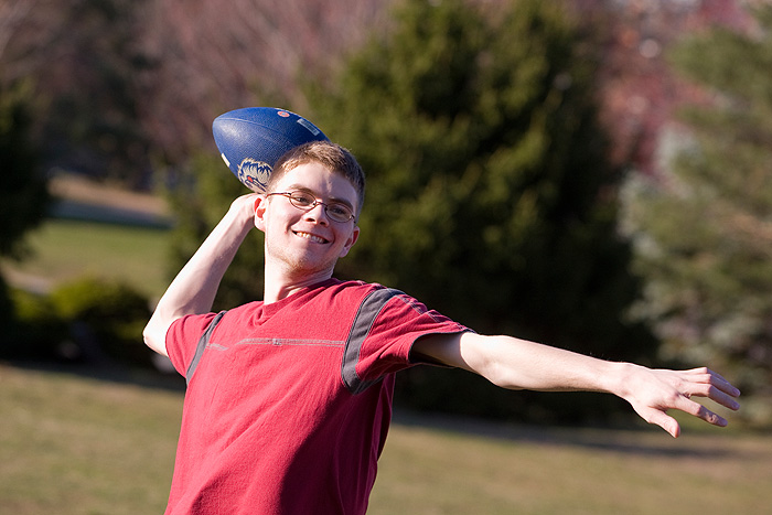 <p>Photo of a student playing touch football. Photo by FJ Gaylor</p>