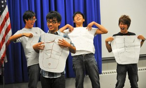"""<p>How many meanings does """"six pack"""" have in English? These UCAELI students from Taiwan show off their newly acquired English language skills at closing ceremonies. Photo by Peter Morenus</p>"""