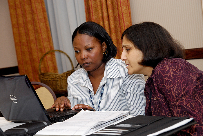 <p>UConn business librarian Shikha Sharma, right, helps out veteran Jacqueline White-Tolefree with her entrepreneurial endeavors at the Entrepreneurial Bootcamp for Vets on September 20. Photo by Lauren Cunningham</p>