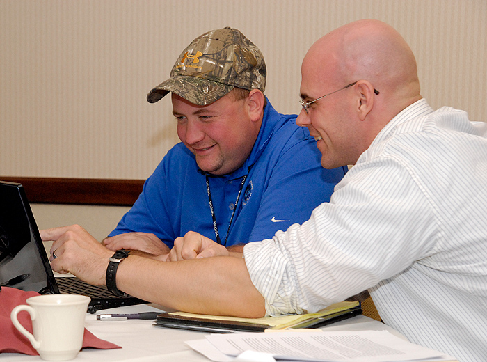 <p>UConn's Jeff Bache, right, helps out veteran Joe Cambell with his entrepreneurial endeavors at the Entrepreneurial Bootcamp for Vets on September 20. Photo by Lauren Cunningham</p>