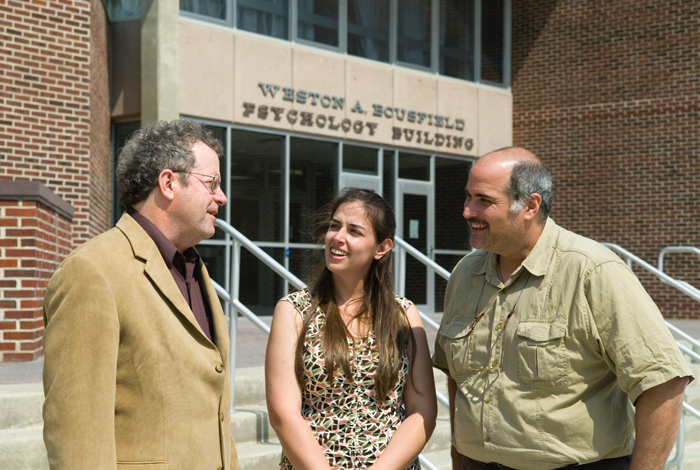 <p>David Kenny, left, Lisa Eaton, and Seth Kalichman, outside the Bousfield Psychology Building. Photo by Pete Morenus</p>