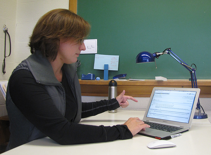 <p>Karen Zook can follow the on-line adventures of her first year Latin class as they chat on an internet forum. Photo by Sheila Foran</p>