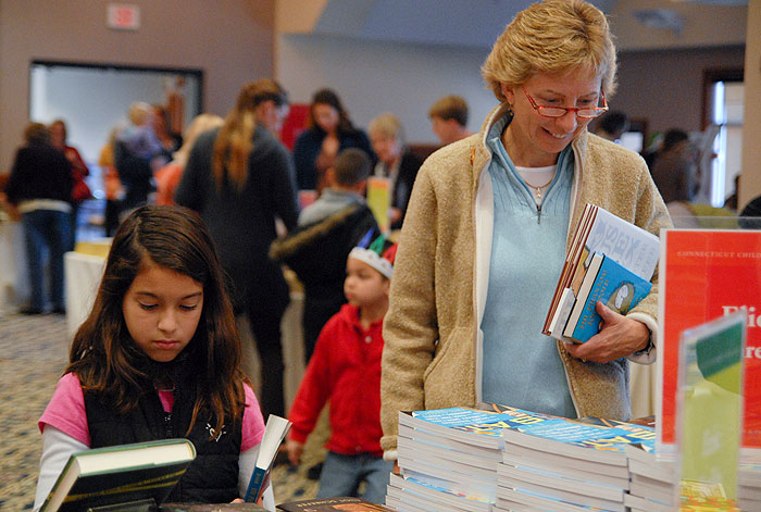 <p>Both kids and parents are browsing through books at the Connecticut Children's Book Fair. Photo by Ariel Dowski</p>