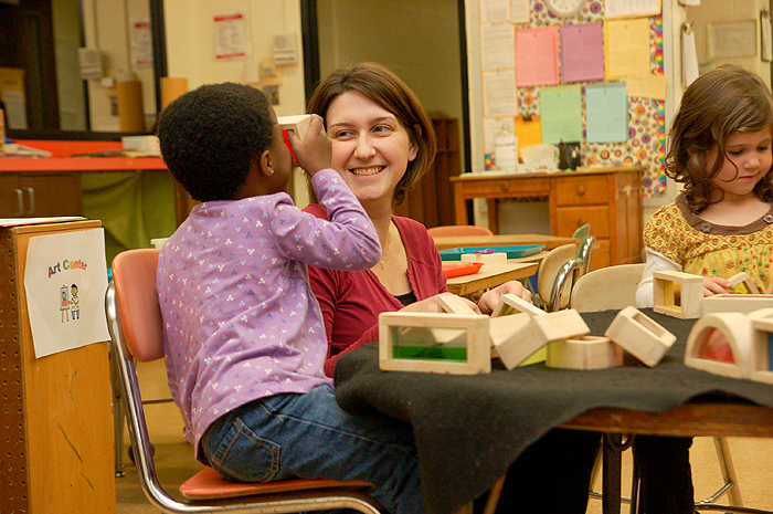 <p>UConn preschool teacher Heather Leeman works with children at the Child Development labs on campus. Photo by  Lauren Cunningham</p>