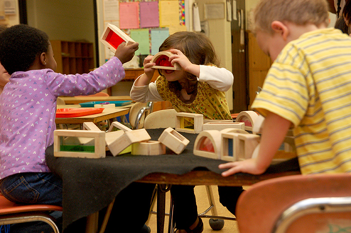 <p>Preschoolers play with blocks from natural materials in an effort to be more environmentally conscious in the Child Development Labs on campus. Photo by  Lauren Cunningham</p>
