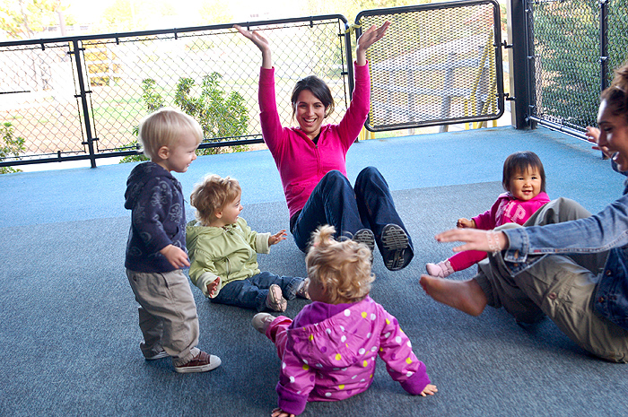 <p>UConn infant teacher Tracy Clark works with children at the Child Development labs on campus. Photo by  Lauren Cunningham</p>