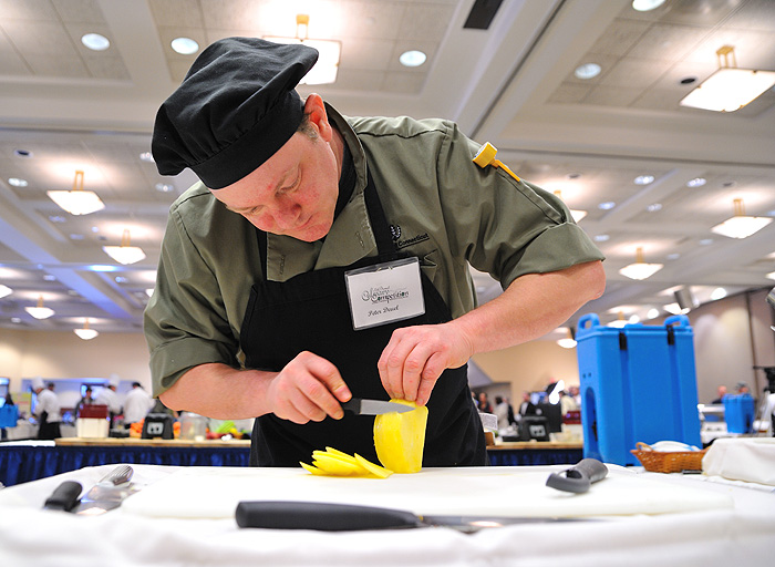 <p>Peter Deuel of the Union Street Market concentrates while making short work of this spud. Photo by Peter Morenus</p>