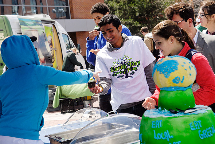 <p>Students lined up to receive free food during Earth Day Spring Fling sponsored by Eco-Husky, the Office of Environmental Policy, and Dining Services on April 21. This annual event on Fairfield Way includes live music, organic local food, eco-friendly vendors, and green companies and student groups that join together to support environmental awareness. Photo by Lauren Cunningham</p>