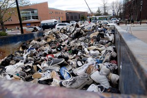 <p>Members of the UConn community made donations to Mt. Sneaker 2011 on the patio of Gampel Pavillion. At the conclusion of each spring semester, the sneakers are donated  to the Nike Reuse-A-Shoe Program to be converted to new surfaces such as running tracks and playgrounds.Photo by Lauren Cunningham</p>