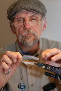 Professional fly tyer Mike Motyl gives a fly-tying demonstration at the UConn Health Center April 11. (Janine Gelineau/UConn Health Center Photo)