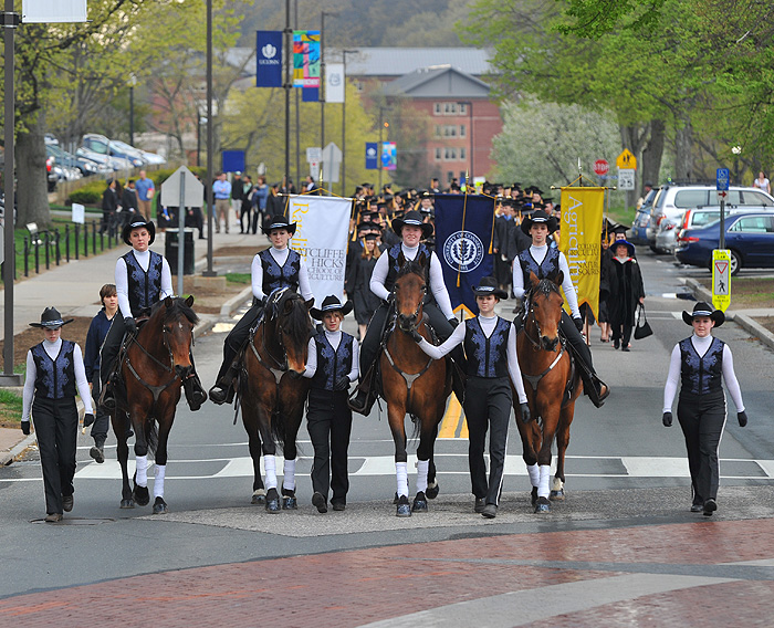 <p>The CANR commencement procession is led down Hillside Road by UConn's Morgan Horse Drill Team. Photo by Peter Morenus</p>