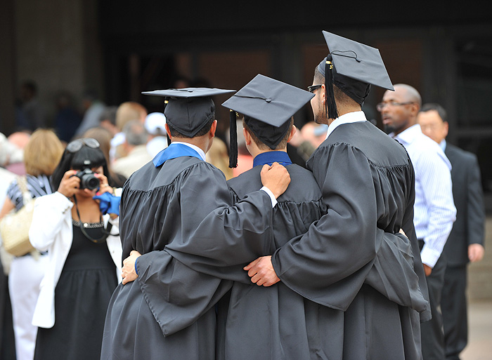 <p>A group of students pose for a photo before the second CLAS commencement ceremony held at Gampel Pavilion. Photo by Peter Morenus</p>