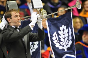 <p>Herald trumpeters of the University Wind Ensemble play during the entrance procession of the graduate commencement ceremony held at Gampel Pavilion. Photo by Peter Morenus</p>