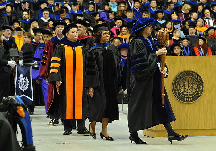 <p>Sally Reis, bearing the mace, leads the faculty procession at the start of the graduate commencement ceremony held at Gampel Pavilion. Photo by Peter Morenus </p>