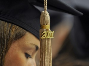 <p>An MBA student's 2011 tassel at the graduate commencement ceremony held at Gampel Pavilion. Photo by Peter Morenus</p>