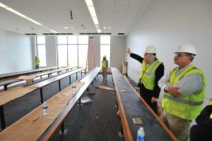 <p>John Warner of architectural and engineering services, right, leads Jeff von Munkwitz-Smith, university registrar, and other members of the registrar's staff on a tour of the West Classroom Building. </p>