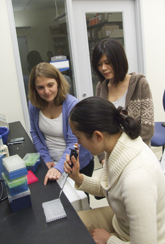 Dr. Nicole Kummer (foreground), Stormy Chamberlain (left), and Ivy Pin-Fang Chen work on finding answers for Angelman syndrome. (File Photo)