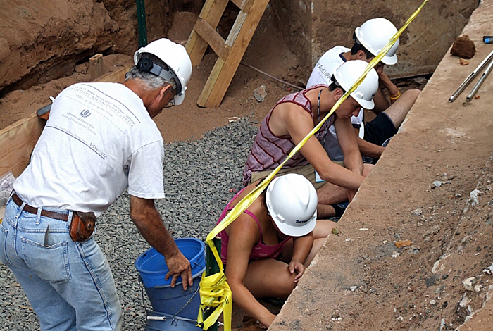 Connecticut State Archaeologist Nicholas Bellantoni works with Mentor Connection students, from left, Rebecca Romero, Anthony Sposato, and Nelson Merchan.