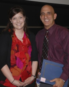 Second-year dental student Melissa Papio presented Dr. Robert Bona the 2011 CAMEL Award at the 2011 Loeser Award Ceremony in Massey Auditorium. (Janine Gelineau/UConn Health Center Photo)