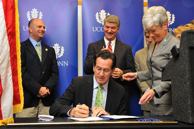Gov. Dannel P. Malloy signs legislation to build a technology park at UConn, during a ceremony held at the Advanced Technology Laboratory