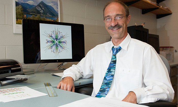 Biologist Peter Burkhard with the molecule he developed to deliver nicotine to the immune system.