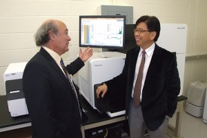 Dr. Marc Lalande, professor and chairman of the Department of Genetics and Developmental Biology, talks with Dr. Edward Liu, Jackson Lab president and CEO. (Tina Encarnacion/UConn Health Center Photo)