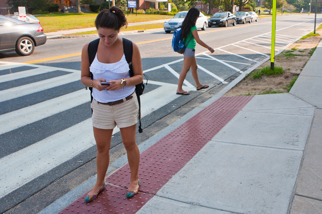 A student uses the mobile map to find a building on campus.