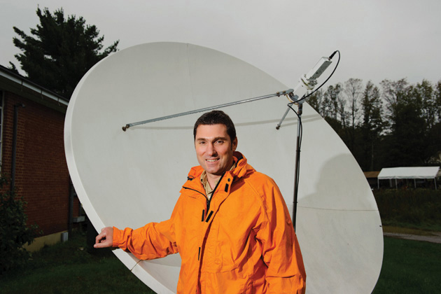 Emmanouil Anagnostou, professor of civil and environmental engineering, stands near a satellite receiving dish on September 7, 2011. (Peter Morenus/UConn Photo)