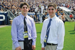 Twins Matthew McDonough '12 (CLAS), left, and Colin McDonough '12 (CLAS) covering a football game at Rentschler Field in East Hartford. (Peter Morenus/UConn Photo)