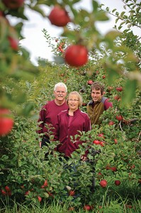 Rick Holmberg '68 (CANR), '72 (ED); Diane Holmberg '72 (ED), '78 MA, '91 MS; and Russ Holmberg '04 (CANR) at the Holmberg Orchards. (Peter Morenus/UConn Photo)
