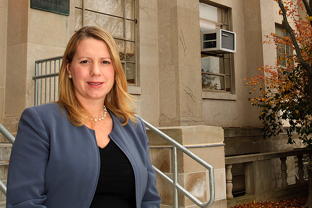 Amy Chesmer poses in front of the Young Building on Nov. 15, 2011. (Sarah Rawlinson/UConn Photo)