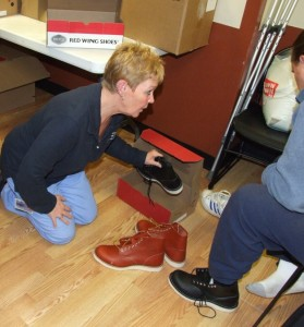 Doreen Smith fits a pair of shoes.
