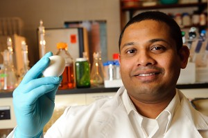 Anup Kollanoor Johny with an egg at his lab in the White Building. (Peter Morenus/UConn Photo)
