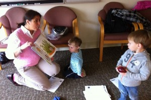 Connections coordinator Jennifer Vendetti (left) reads with toddlers at a recent Nurturing Families Network group program. (Photo provided by Jennifer Vendetti)